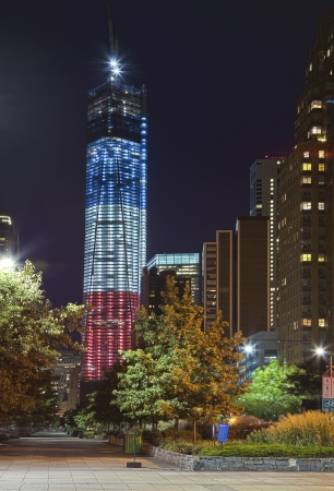 on cloud nine: NEW YORK CITY - SEPTEMBER 16: One World Trade Center (known as the Freedom Tower) is shown under new  illumination on September 16, 2012 in New York, New York.