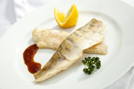 the perch: Grilled Pike perch with lemon and tomato sauce Stock Photo