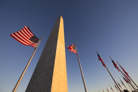 us government: Washington Monument at Sunset with US flag