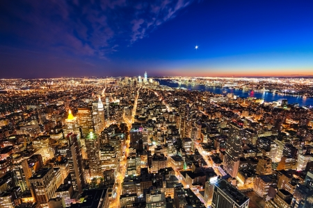 New York City and New Jersey skyline at night w the Freedom tower and Brooklyn bridge photo