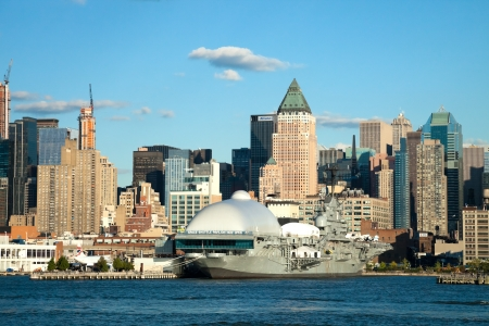 intrepid: NEW YORK CITY, USA - SEPTEMBER 24: New York Uptown and Intrepid Sea, Air and Space Museum on September 24, 2012. It is one of Americas leading historic and educational institutions and is opened since 1982 and is centered on the aircraft carrier Intrepid.