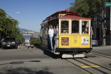permanently: SAN FRANCISCO - NOVEMBER 3: The Cable car tram, November 3rd, 2012 in San Francisco, USA. The San Francisco cable car system is world last permanently manually operated cable car system. Lines were established between 1873 and 1890.