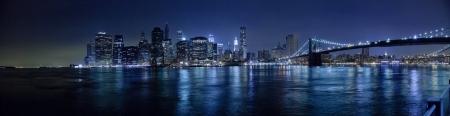 The New York City skyline in the night w Brooklyn Bridge Hi-Res photo