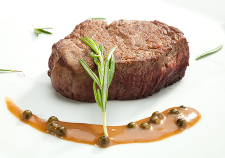 Beefsteak Tenderloin with the rosemary on the white plate