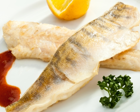 zander: Grilled Pike perch with lemon and tomato sauce Stock Photo