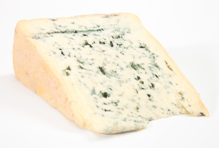 Wedge of full fat soft blue cheese Stock Photo