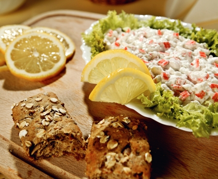 crab meat: Crab dip with a lemon and fresh bread