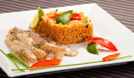 whitefish: Grilled codfish with red lentil and bell pepper slices
