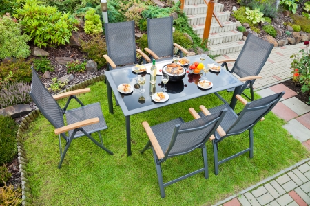 The metal Garden furniture by the house and the pool
