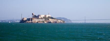 Alcatraz jail in San Francisco bay and Bay Bridge photo