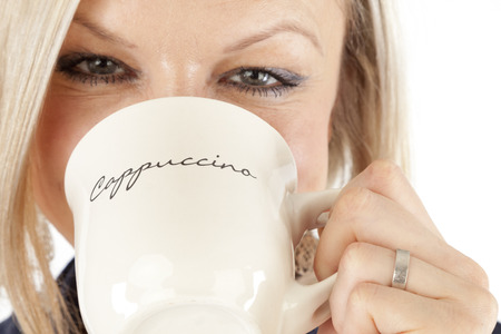 Beautiful Woman is holding the mug of Coffee photo
