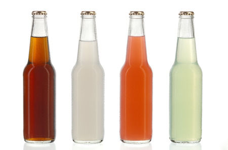 Four assorted soda bottles, non-alcoholic drinks with water drops Standard-Bild