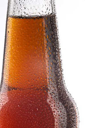 Bottle of beer with droplets close-up photo