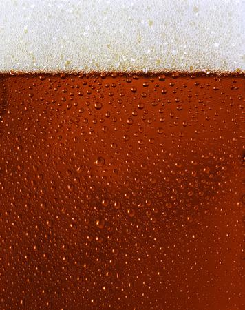 Dewy Black beer glass texture w froth Standard-Bild