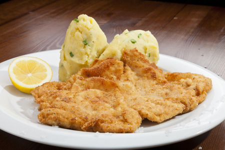 Vienna schnitzel with potato Vienna salad photo