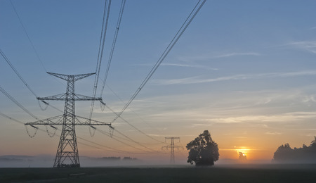 temelin: Electricity Pylons at dramatic sunrise and power plant Temelin - Czech Republic Stock Photo
