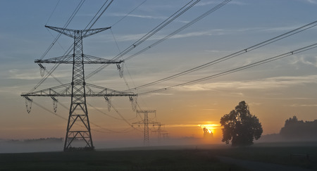 Electricity Pylons at dramatic sunrise and power plant Temelin - Czech Republic photo