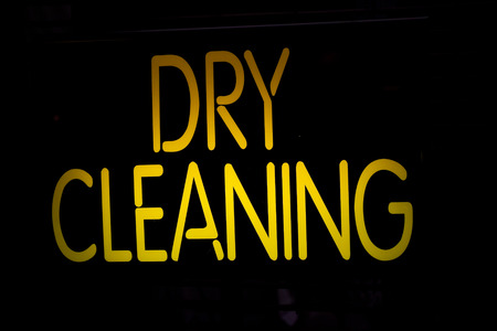 dry cleaning: Neon Sign Dry Cleaning on Black Background Stock Photo