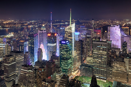 New York City, USA - October 5: New York Uptown and Times Square on October 5, 2014, panorama aerial view at night with office building and skyscrapers skyline.