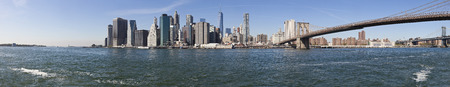 The New York City Downtown panorama at the afternoon w Brooklyn Bridge photo