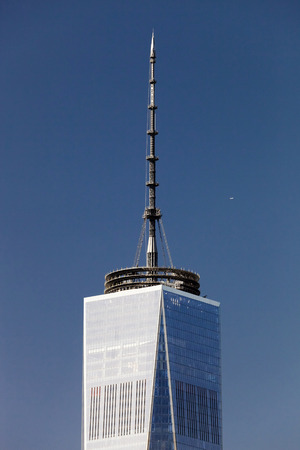freedom tower: New York, USA, October 3, 2014: The top of the Freedom Tower with 408 feet (124 m) mast containing the broadcasting antenna gave the tower symbolic height of 1,776 feet (541 m) Editorial