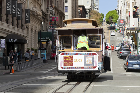 San Francisco-USA, November 14, 2014: The passengers are going from the station Hyde by the Cable car Tram to the Center of San Francisco. The Cable car is one of the San Francisco Attractions. Taken on Hyde street around 3pm, Nov 14, 2014