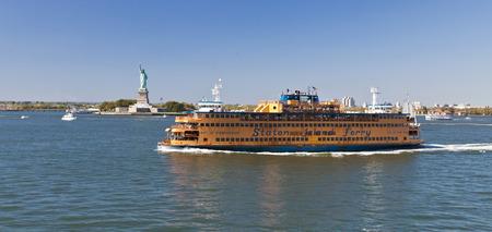 liberty island: New York, USA, September 27, 2014: Staten Island Ferry provides 22 million people a year (70,000 passengers a day) with ferry service between St. George on Staten Island and Whitehall Street in lower Manhattan