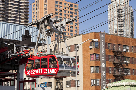 uptown: New York, USA-October 9, 2014: The famous Roosevelt Island cable tram car that connects Roosevelt Island to Manhattan Uptown. Each cabin has a capacity of up to 110 people and makes app 115 trips per day. Editorial
