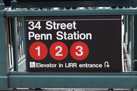 billion: New York, USA-October 7, 2014 : Subway entrance in Lower Manhattan at Pensylvania Station. In 2013, the New York subway delivered over 1.71 billion rides.
