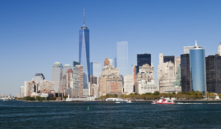 9 11: New York City, USA - September 27, 2014: New York panorama and One World Trade Center (formerly known as the Freedom Tower). Freedom Tower is shown finished with antenna.