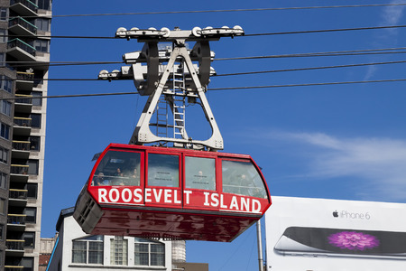 roosevelt: New York, USA-October 9, 2014: The famous Roosevelt Island cable tram car that connects Roosevelt Island to Manhattan Uptown. Each cabin has a capacity of up to 110 people and makes app 115 trips per day. Editorial