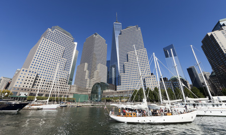 New York, USA-September 27, 2014:Tall ships docked at the North Cove Marina at Battery Park in Manhattan and financial center panorama
