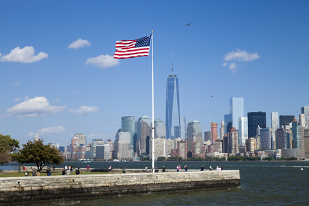 New York City, USA - October 6, 2014: New York panorama, One World Trade Center (formerly known as the Freedom Tower) and Ellis Island. Freedom Tower is shown finished with antenna.