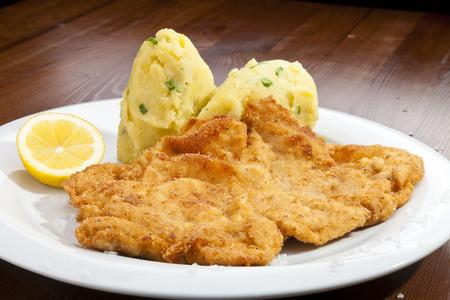 Vienna schnitzel with mash potatoes photo