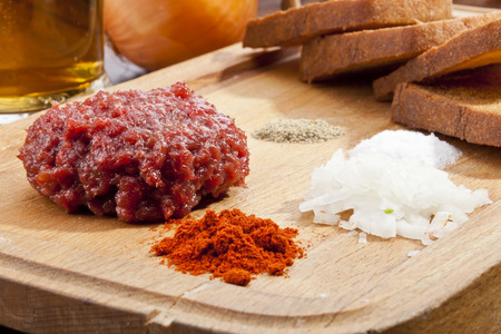 trencher: Steak tartar with the fried bread on the wooden trencher