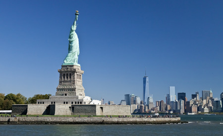 The Statue of Liberty at New York City with the Freedom Tower