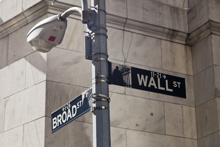 street name sign: New York, USA - October 5, 2014: Wall Street street sign on the pole in New York. Wall Street is 0.7 miles long street which gave its name to the the financial district of New York City. Editorial