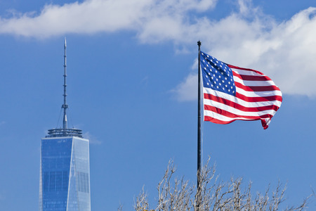 9 11: New York, USA - October 8, 2014: Freedom Tower in Lower Manhattan and US Flag. One World Trade Center is the tallest building in the Western Hemisphere and the third-tallest building in the world.