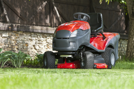 Lawn mower at the garden Stock Photo