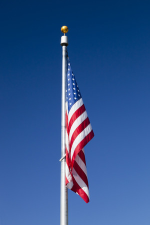 flag pole: USA flag without the wind in the sky