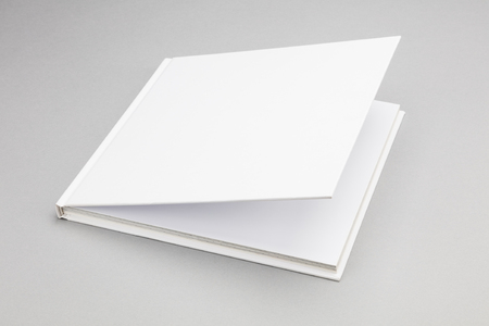 book cover: Blank book with ajar white cover 8,5 x 8,5 in