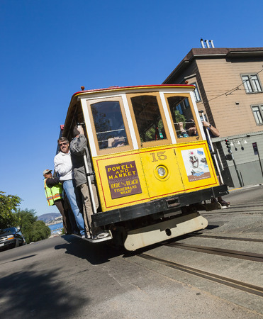 permanently: SAN FRANCISCO, USA - NOVEMBER 3, 2012: The Cable car tram. The San Francisco cable car system is world last permanently manually operated cable car system. Lines were established betw. 1873 and 1890.