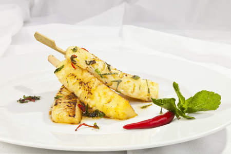 vegetarian food: Grilled ananas with honey and mint leaves Stock Photo
