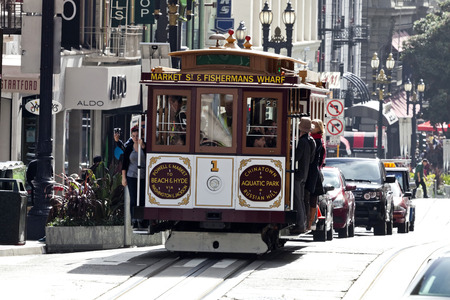 permanently: Sajn Francisco, USA - November 14, 2014: The Cable car tram. The San Francisco cable car system is world last permanently manually operated cable car system. Lines were established between 1873 and 1890.