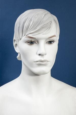 Figurine Head, monochrome on the blue background