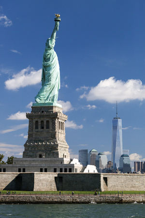 freedom tower: The Statue of Liberty at New York City with the Freedom Tower