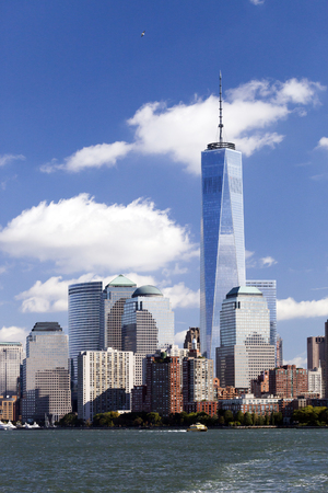 world trade: NEW YORK - OCTOBER 8: Freedom Tower in Lower Manhattan on October 8, 2014. One World Trade Center is the tallest building in the Western Hemisphere and the third-tallest building in the world
