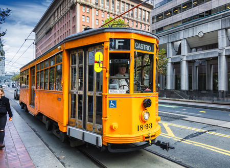 come in: San Francisco CA, USA, November 6, 2016 : Historic street car transporting passengers in San Fransisco CA, USA. San Francisco street cars come from all around the world.