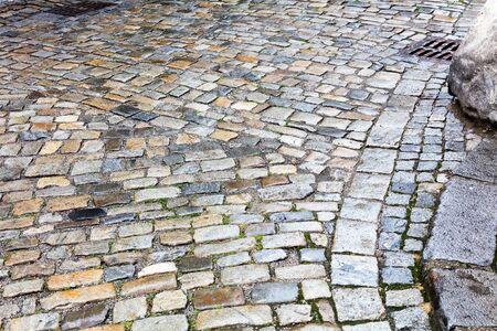 Street pavement and old wet cobblestones Reklamní fotografie - 139513094