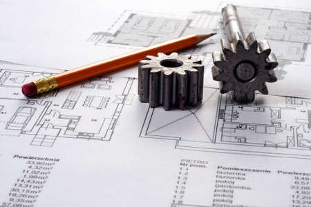 Tools on Blueprints including sprocked stacks and pencil. House plans printed on white paper. photo